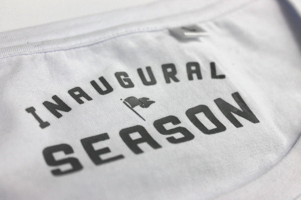 Neck label of a premium, v-neck t-shirt made of white cotton.