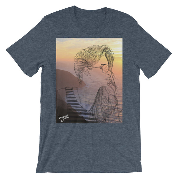 A heathered navy tshirt, with a print of a girl and sunset. On a white background.