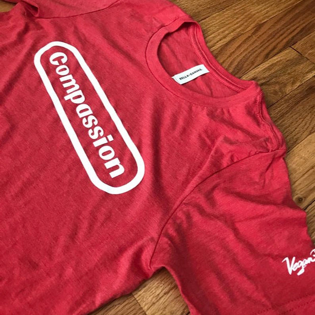 Compassion Unisex Tee - Red - The Grinning Goat
