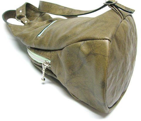 leather backpack, sling bag, knapsack showing oval bottom
