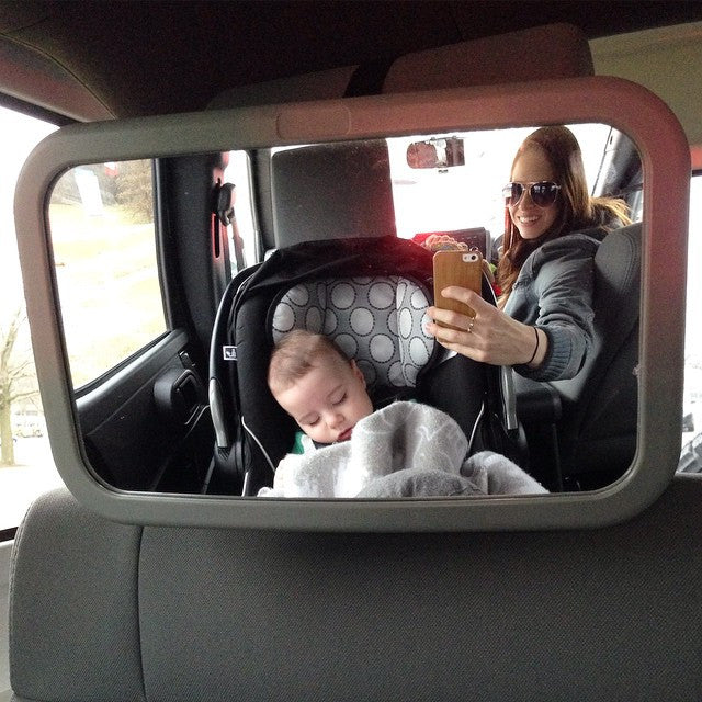 Noah and his mother in a care with a mirror to see the back seat