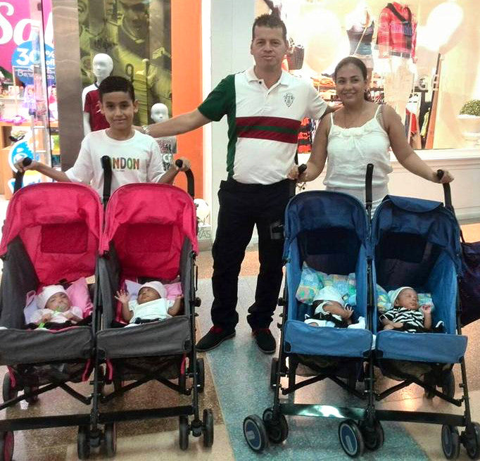 Family with quadruples in strollers