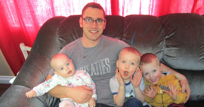 Father with 3 children on couch