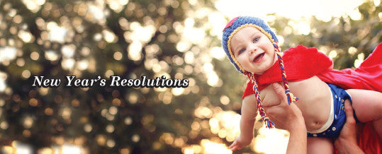 Hands holding baby in the air with overlay text New Year's Resolutions