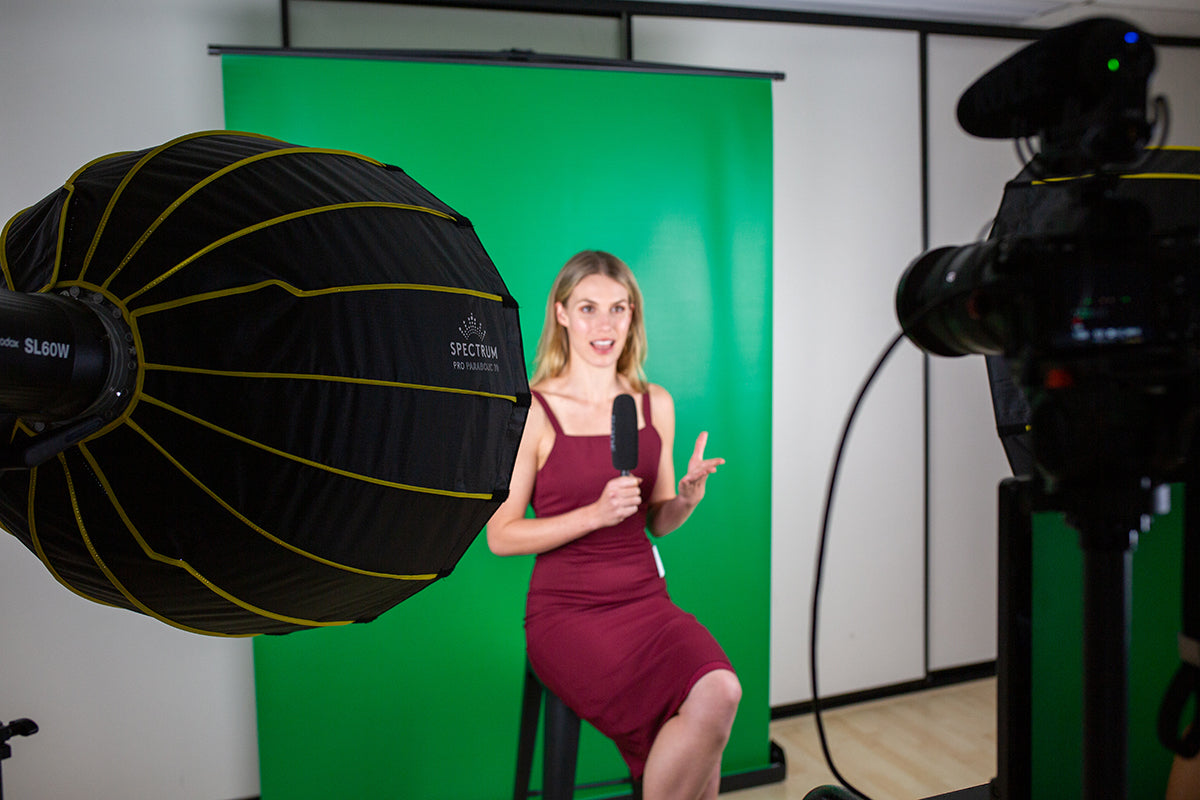 Videography home studio lighting setup with green screen and softbox lights