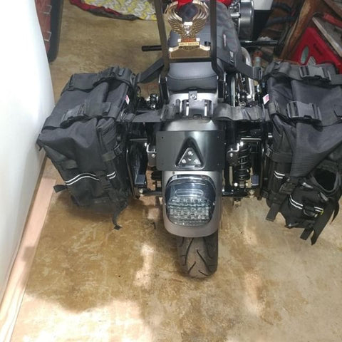 Wolfman Rocky Mountain Saddlebags mounted on Harley Davidson Grim Parts Co