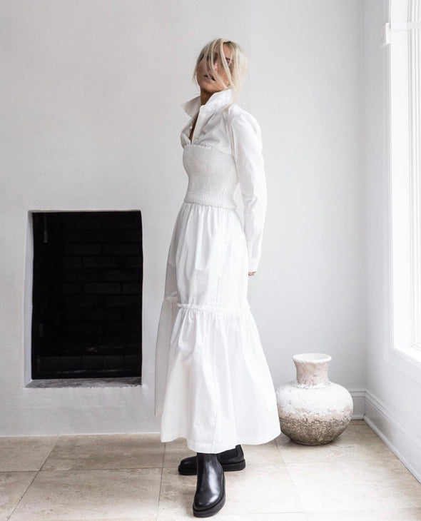 HI LO The Label Zephyr dress in white styled with white shirt and black boots