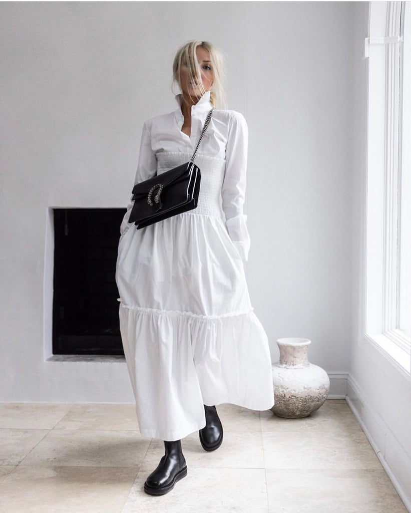 HI LO The Label Zephyr dress in white styled with white shirt, black boots and black Gucci bag