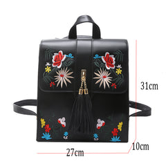 Size chart for a black embroidered floral bag.