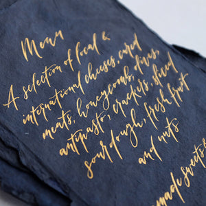 Gold calligraphy on handmade indigo paper
