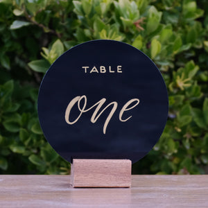 Hire Me: Acrylic Round Modern Black With Gold Lettering Table Number Sign + Stand - FoxAndHart