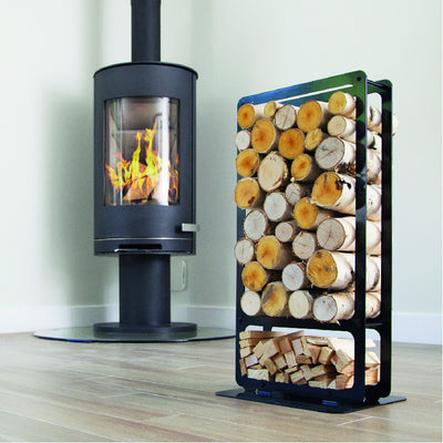 One of Ardour's Classic metal log baskets in jet black. It is a tall rectangular shape with two compartments; A small one at the bottom to store kindling and a large one above to store the logs. Its compact design allows logs to be stored in a smaller footprint than a traditional wicker basket.