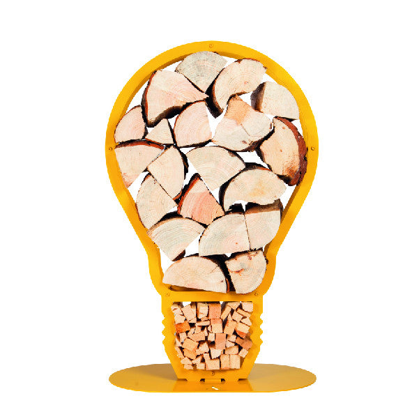 A front view of one of Ardour's light bulb shaped metal log baskets in honey yellow. It is a profile of a screw-in style light bulb attached to a base-plate. The design has two compartments; A small one at the top to store kindling and a large one for the main body of the bulb to store the logs.