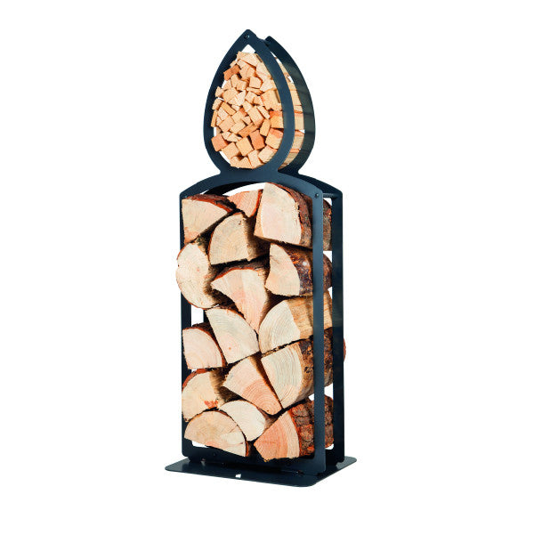 One of Ardour's candle shaped metal log baskets in jet black. This isometric view shows a tall candle she with two compartments; A small one in the shape of a flame at the top. this has kindling stored in it. A large opening represents the main body of the candle and stores the logs. Its compact design means logs can be stored in a smaller footprint than a traditional wicker basket