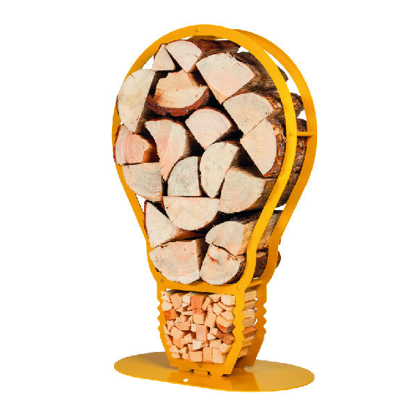 An isometric view of one of Ardour's light bulb shaped metal log baskets in honey yellow. It is a profile of a screw-in style light bulb attached to a base-plate. The design has two compartments; A small one at the top to store kindling and a large one for the main body of the bulb to store the logs.