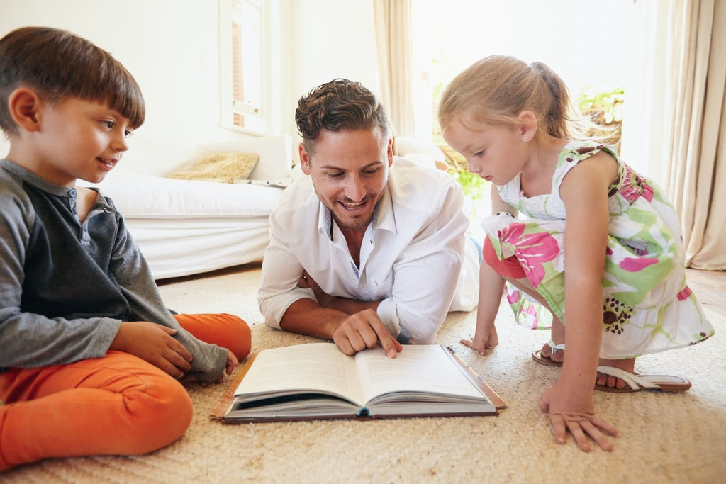 father reading to kids