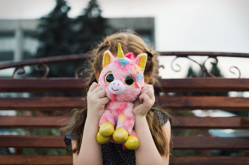 small girl holding a cuddly toy