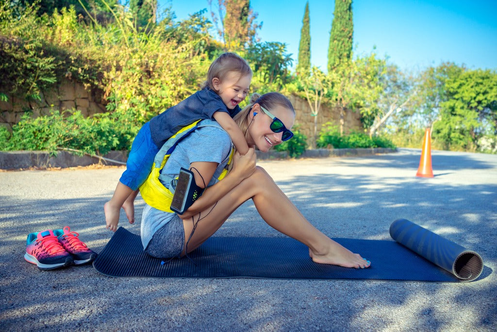 Sportive mother with child outdoors