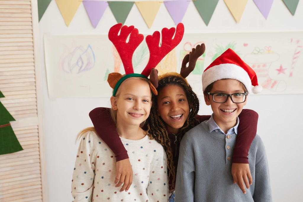 Three kids looking forward to Christmas