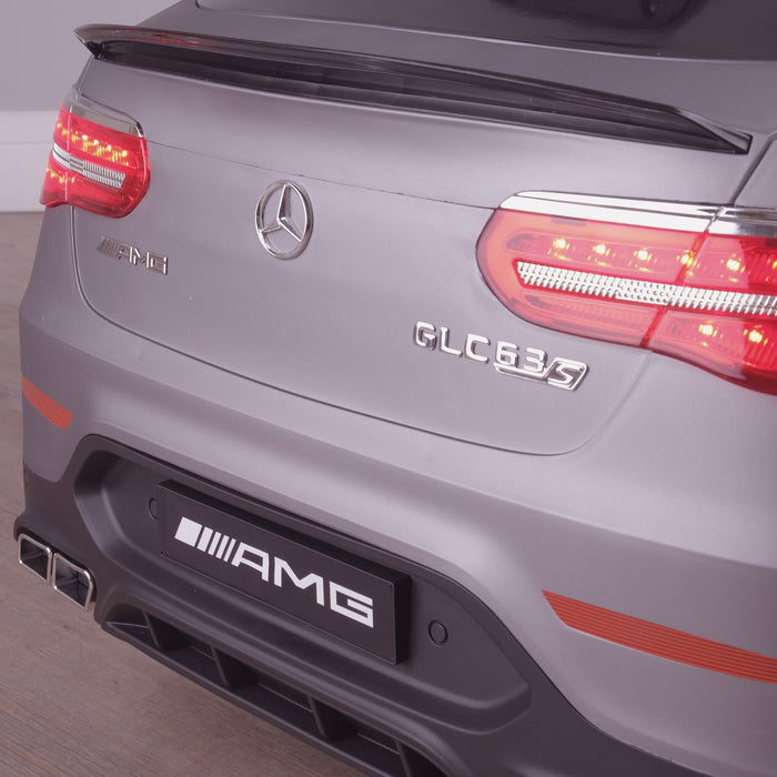 kids 12v electric mercedes glc 63s coupe battery car jeep pick up battery operated ride on car with parental remote control mat gray rear close up view benz amg licensed 2wd painted red