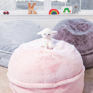 three beanbags, furry and shiny in a childs playroom