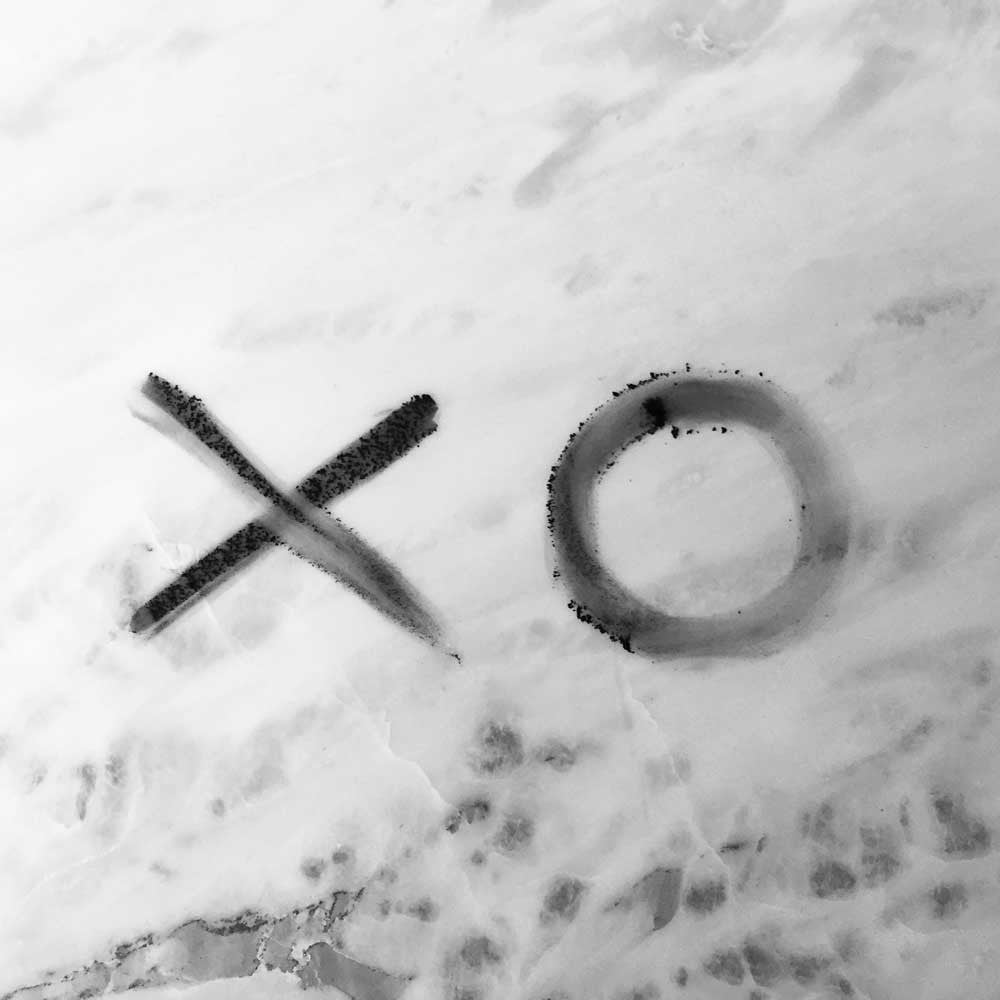 XO written in Activated Charcoal Powder