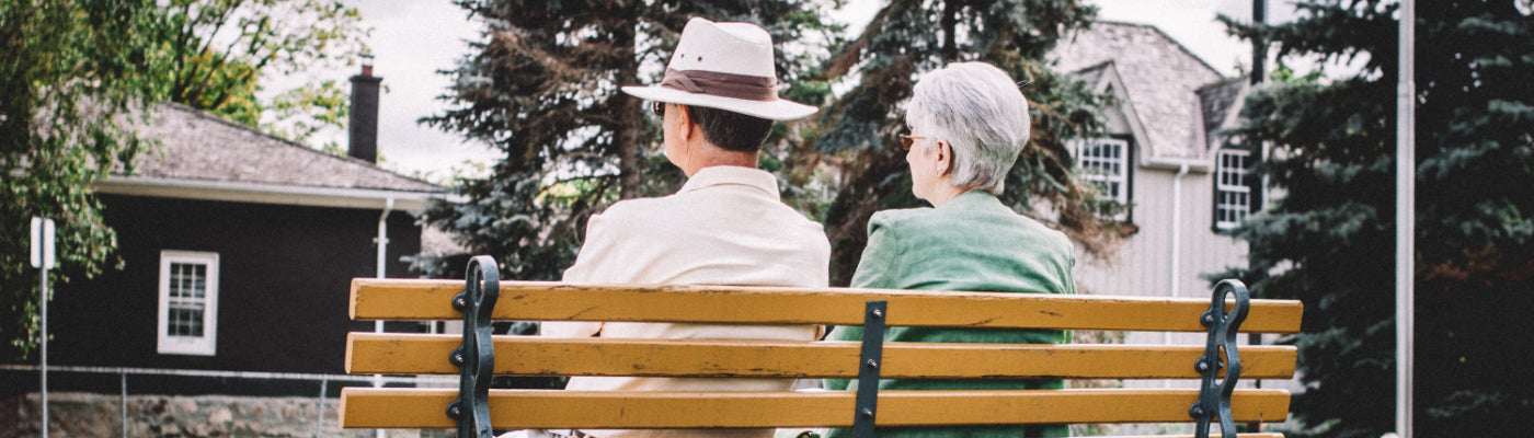 eldery couple on a bench