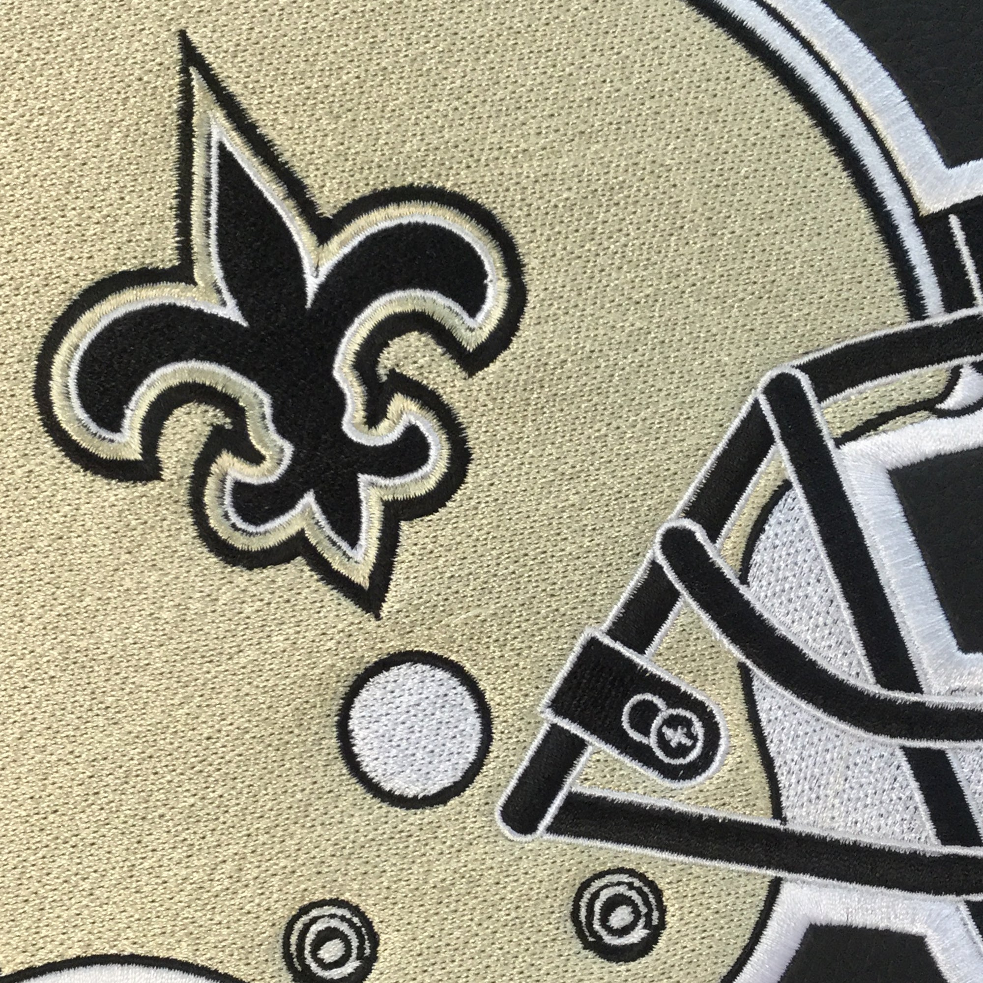 Silver Sofa with  New Orleans Saints Helmet Logo