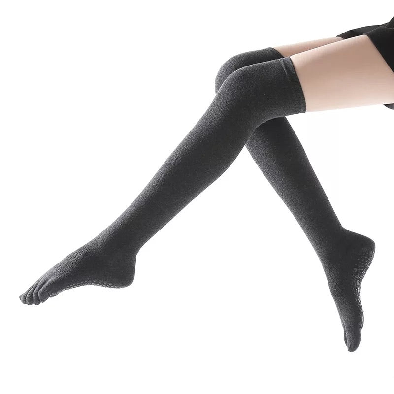 Silicon dots on the bottoms of these overknee socks give you more control in barre and yoga.