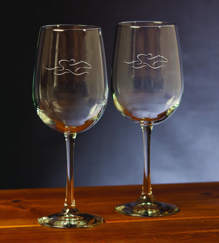 A set of 18.5 ounce all purpose stemware glasses beautifully etched with the EMBRACE THE RACE icon.
