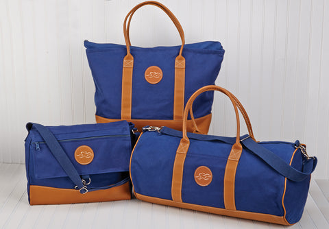 "23""W x 14""H x 6""D Large navy canvas and leather tote bag perfect for a night away!  Leather handles, bottom, trim and EMBRACE THE RACE logo!"