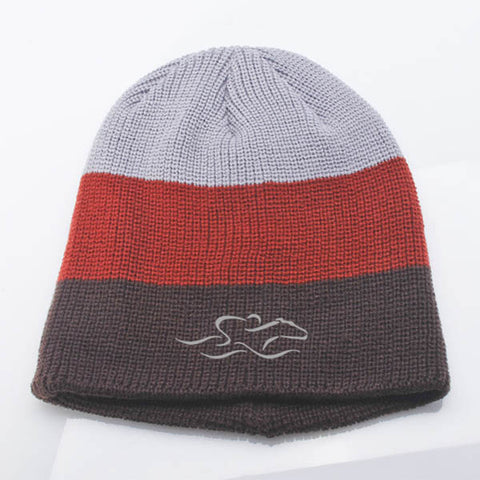 An uncuffed tri-color knit beanie in gray, brown and cinnamon. EMBRACE THE RACE icon center front and wordmark on the back