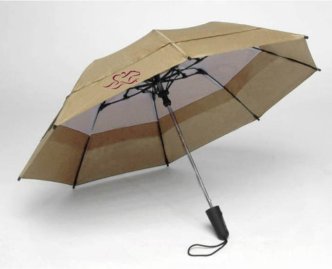 A tan EMBRACE THE RACE windbrella with our horse racing icon on one side and our wordmark on the other in cardinal.