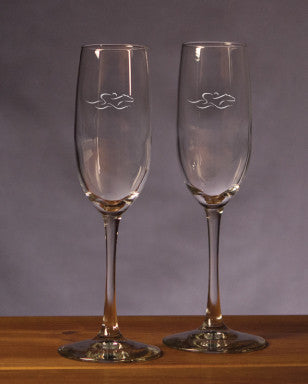 A set of 8 ounce beautifully etched champagne flutes with the EMBRACE THE RACE icon.