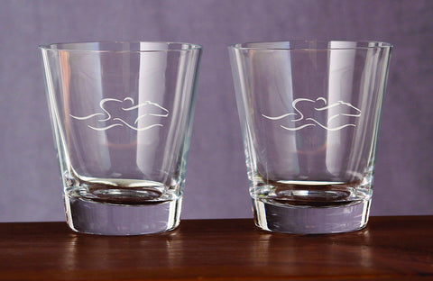 A set of 10 ounce flared rocks glasses etched with the EMBRACE THE RACE icon.