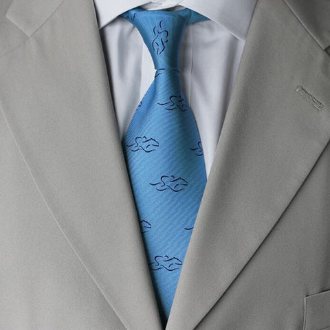 Beautiful light blue 100% silk tie printed with our navy EMBRACE THE RACE icon.