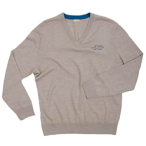 A lightweight LS merino wool sweater in tan with the EMBRACE THE RACE logo embroidered on the left chest