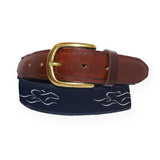 A mens signature canvas and leather belt.  Our signature navy and white EMBRACE THE RACE ribbon on a navy backiing adorned with a leather tip and brass buckle.