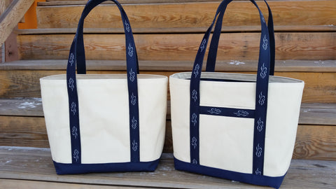 A heavy duty canvas tote bag.  Fully lined with navy liner to match the custom EMBRACE THE RACE ribbon sewn handles and solid navy canvas bottom.