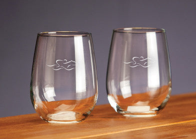 A set of 17 ounce stemless wine glasses beautifully etched with the EMBRACE THE RACE icon.