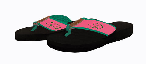Womens black soled wedge flip flops featuring our custom pink and green ribbon on green backing.