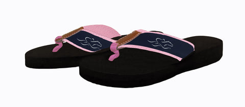 Womens black soled wedge flip flops featuring our custom navy and white ribbon on pink backing.