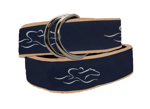 A womens signature ribbon belt featuring navy ribbon with our white icon stitched on a canvas tan backing.