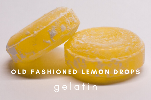 Two old fashioned lemon drops on a white background with the words old fashioned lemon drops gelatin