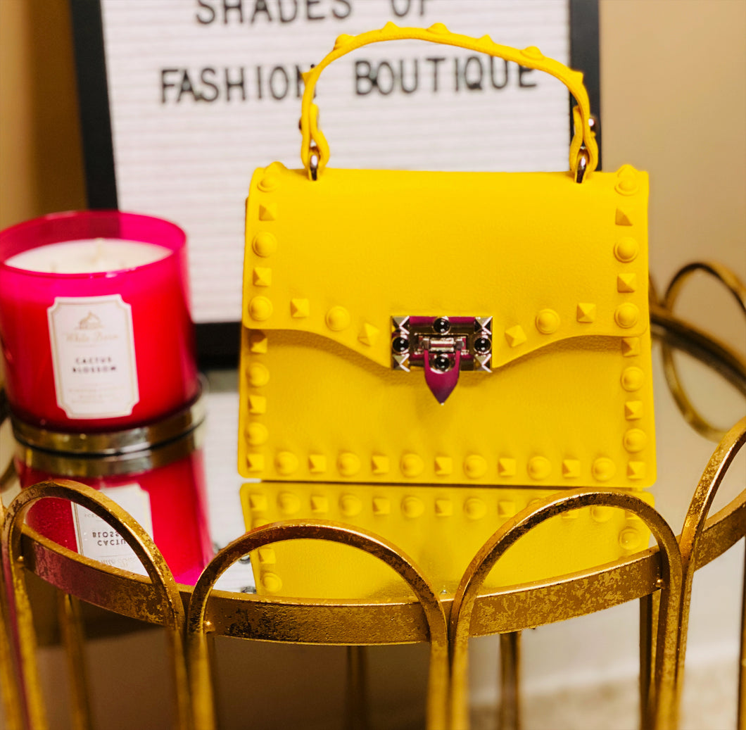 Yellow studded clutch