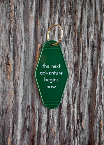 THE NEXT ADVENTURE BEGINS NOW KEY TAG