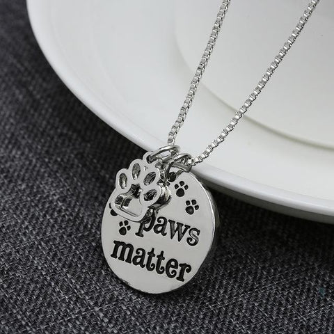 Image of cat necklace, rescue cat, rescue cat necklace, all paws matter, paws, dog necklace