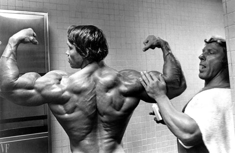 Arnold Schwarzenegger's shoulder workout high volume heavy weight lots of reps and sets