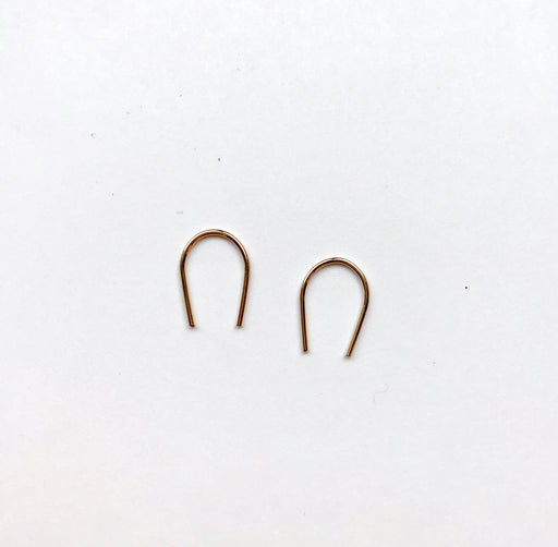 Gold curve earrings