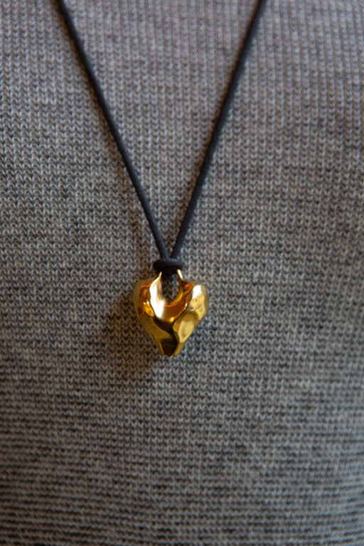 Vintage hammered brass heart pendant
